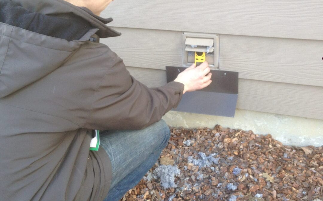 Dryer ducks employee inspecting the side of a house